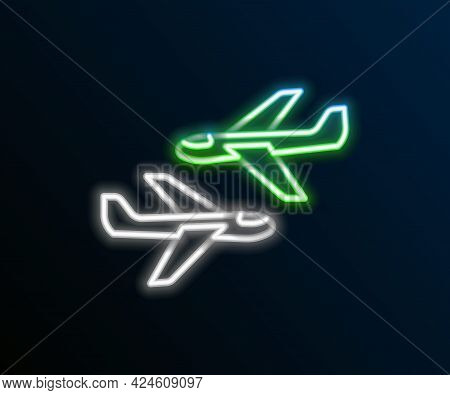 Glowing Neon Line Plane Icon Isolated On Black Background. Flying Airplane Icon. Airliner Sign. Colo