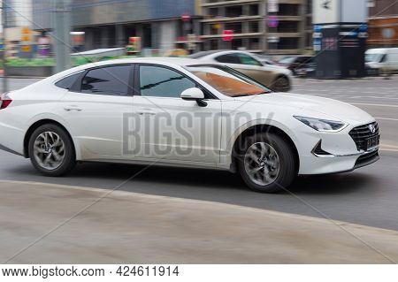 Moscow, Russia - March 2021: Hyundai Sonata Dn8 Rides On The City Road. White Sedan Car Rushes Along