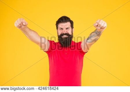 Joyful Guy. Inner Energy. Motivated For Success. Happy Man Show Success Gesture Yellow Background. V