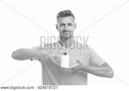 Pills And Supplements. Handsome Man Hold Bottle With Pills Or Vitamins. Nutrition In Pills. Fitness