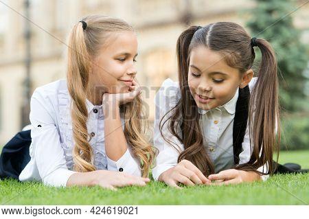 Childhood Friends. Happy Children Relax On Green Grass. Happy Childhood. Enjoying Childhood Years. C