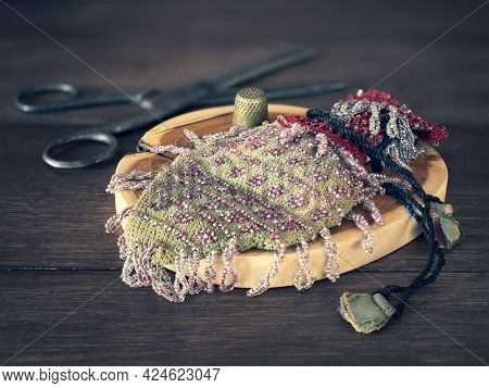 Old Handcraft Supplies For Making Vintage Beaded Hand Bag With Drawstring Ties. Concept Of Hand Maki