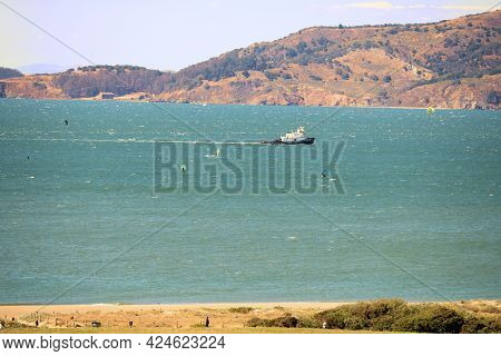 Fishing Boat Riding On The San Francisco Bay With Rural Hills At The North Bay Beyond Taken In San F