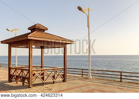 Pick Nick Bbq On A Sea Concept. Shore Recreation Zone With Shelter Spot And A View At The Sea