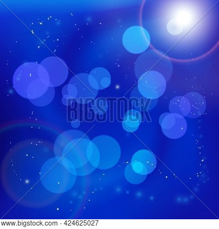 Abstract Light Bokeh Spots On Smooth Blue Swirly Background With Bright Lens Flare. Underwater Or Sp