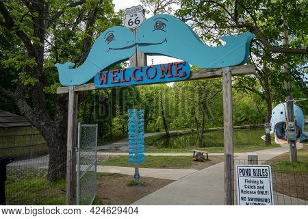Catoosa, Oklahoma - May 5, 2021: Welcome Sign For The Famous Road Side Attraction Blue Whale Of Cato