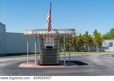 Carthage, Missouri - May 5, 2021: Ticket Booth At The 66 Drive-in Theatre And Neon Sign, Along Old R