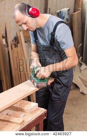 Carpenter With Power Grinder
