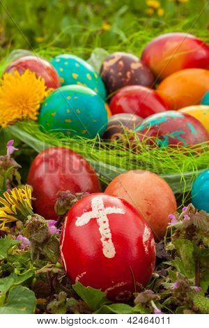 Colorful Easter Eggs With Flowers, Outside. Red Egg With A Cross On The Front