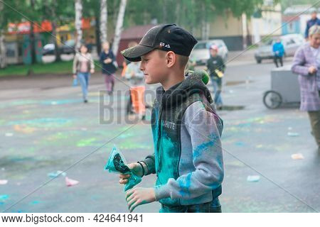 Novokuznetsk, Kemerovo Region, Russia - June 05, 2021 :: Boy With Colorful Face Painted With Holi Po
