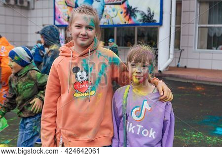 Novokuznetsk, Kemerovo Region, Russia - June 05, 2021 :: Girls With Colorful Faces Painted With Holi
