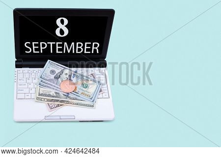 8th Day Of September. Laptop With The Date Of 8 September And Cryptocurrency Bitcoin, Dollars On A B
