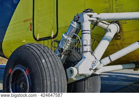 Helicopter Landing Gear With Aircraft Thrust Pad. Landing Gear Of Military Helicopter. Wheel Of Airp