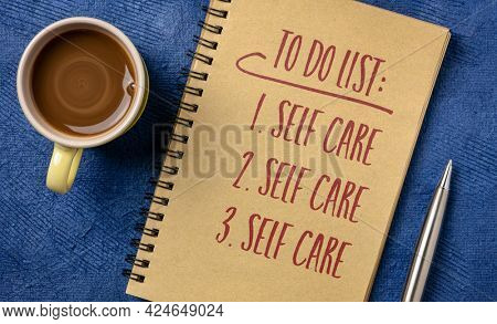 to do list - self care, handwriting in a spiral notebook with a cup of coffee, mental, emotional, and physical health concept