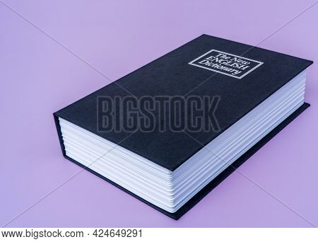 Big Black Book English Dictionary On Violet Isolated Background With Copy Space For Your Text. High