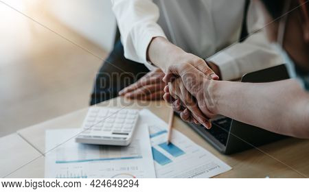 Financial Accountants And Marketers Shaking Hand To Congratulate The Real Estate Performance, Busine