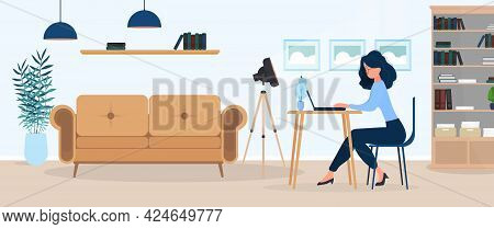Girl Works At A Laptop In A Stylish Office. A Study, A Computer, A Sofa, A Wardrobe, A Bookcase With