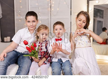 Happy Childhood. Group Children. Resting Children. Funny Kids. Smiling Boys And Girls. Beautiful Chi