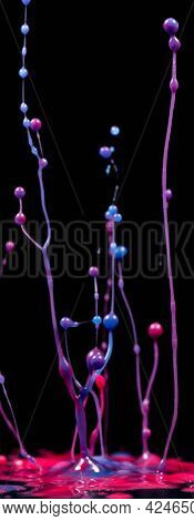 spray paint or ink in ultraviolet light on a black background