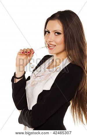 brunette posing with glasses