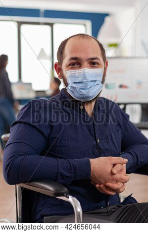 Employee With Disabilities, Invalid, Handicapped Paralized With Face Mask Against Coronavirus Lookin