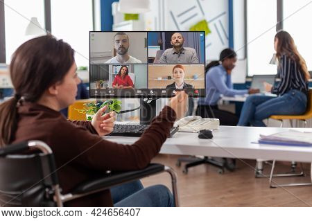 Handicapped Paralyzed Invalid Employee During Virtual Meeting Talking On Videocall Working From Star
