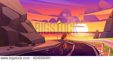 Girl On Bicycle Riding Mountain Road At Dusk Seascape View. Young Woman Bike Trip, Travel At Highway