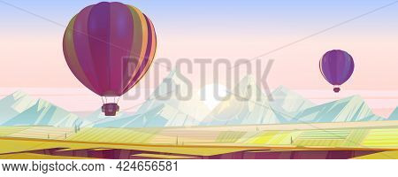 Hot Air Balloons Flying Above Green Fields And Mountain Peaks In Pink Morning Sky. Scenery Landscape