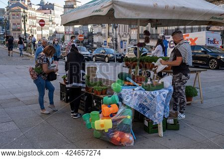 PORTO, PORTUGAL - JUN 23, 2021: On the eve of the Sao Joao Festival. Very popular holiday is celebrated June 23-24 at midnight, but due to the pandemic this year, no fireworks shows, and concerts.