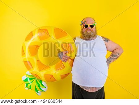 Fat Delusion Man With Wig In Head Is Ready To Swim With A Donut Lifesaver