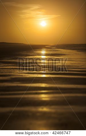 An image of a beautiful sunset over the ocean - Australia 80 mile beach
