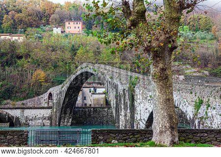 Italy. Province of Tuscany. Ponte della Maddalena - medieval bridge of magnificent architecture over the Serchio River in the vicinity of the small town of Borgo a Mozzano