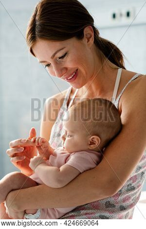 Happy Cheerful Family. Mother And Baby Kissing, Laughing And Hugging