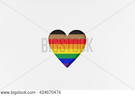 Heart Shape With New Redesigned Lgbtq Pride Flag On White Cardboard. Printed Cardboard With Die-cut