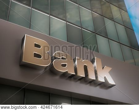 3D rendering of closeup of Bank building with glass pane facade looking up