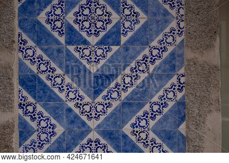Traditional old tiles wall on the street Portuguese, azulejos ceramic. Porto, Portugal.