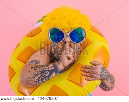 Fat Man With Wig In Head Is Ready To Swim With A Donut Lifesaver
