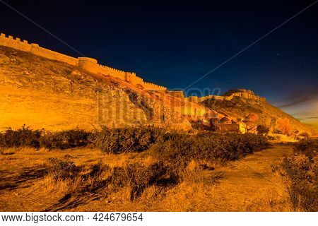 Panoramic Night View Onto Van Fortress, Van, Turkey. Citadel & Walls Lighted By Night Lights With Go