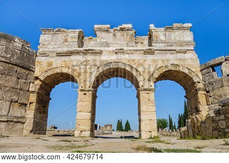 Facade Of Domitian Gates In Antique City Hierapolis, Pamukkale, Turkey. Built In Honor Of Roman Empe