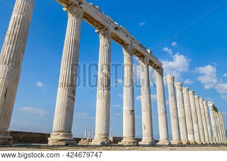 View In Perspective Onto Antique Street Colonnade. All Columns Made In Corinthian Order. Picture Tak