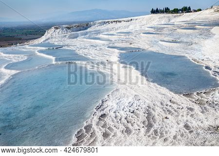 Snow White Travertine Terraces Of Pamukkale, Turkey. Pools Filled With Water From Hot Spring. Struct