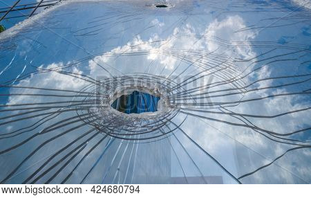Broken glass, glass cracked from an accident with cloud background