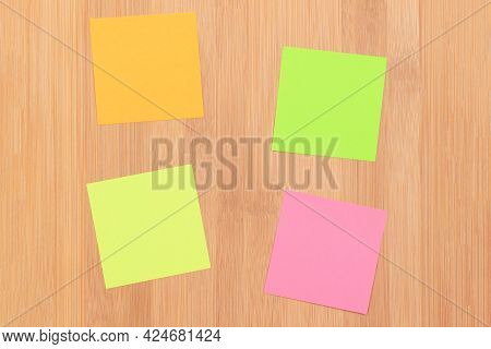 Colored Sticky Notes With Copyspace Pinned To The Wooden Message Board. To Do List Reminder In Offic