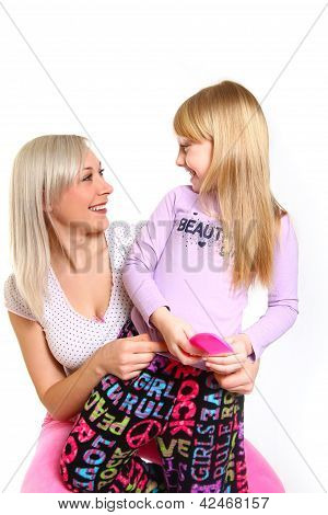 Happy Mother And Daughter With A Comb Looking At Each Other Isolated