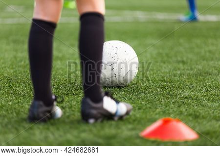Soccer Player Footballer Sportsman On Training Field. Young Soccer Player On Practice Pitch. Red Soc