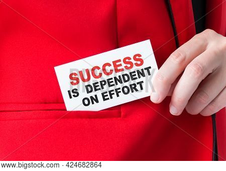 Businessman Putting A Card With Text Success Is Dependent On Effort In The Pocket
