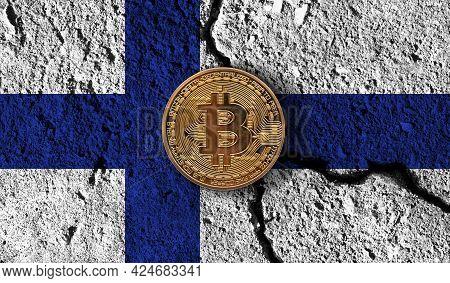 Bitcoin Crypto Currency Coin With Cracked Finland Flag. Crypto Restrictions