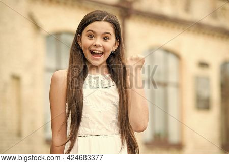 Happiness Makes You Beautiful. Happy Child Make Winner Gesture Outdoors. Little Girl Feel Happiness.