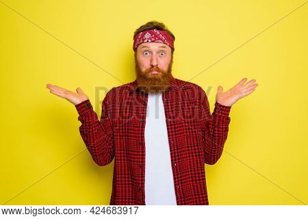 Undecided Man With Beard And Bandana In Head
