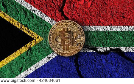 Bitcoin Crypto Currency Coin With Cracked South Africa Flag. Crypto Restrictions